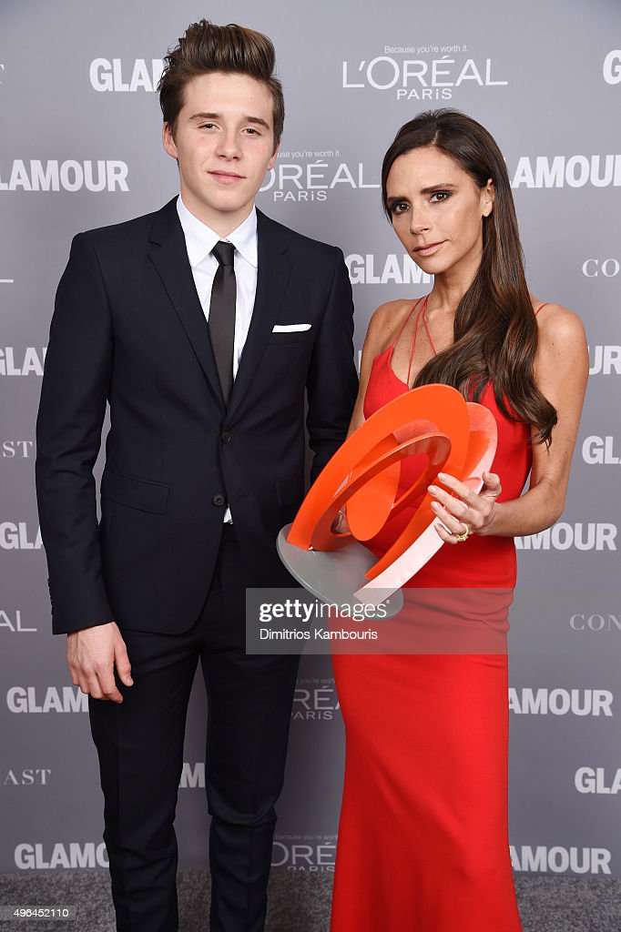 Brooklyn Beckham (L) and designer Victoria Beckham pose backstage with her award at the 2015 Glamour Women Of The Year Awards at Carnegie Hall on November 9, 2015 in New York City.