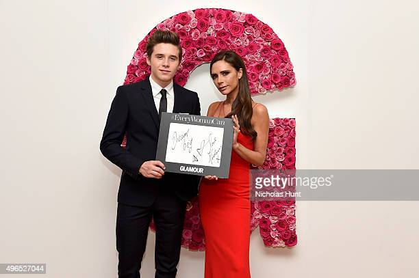 Brooklyn Beckham and designer Victoria Beckham pose for a photo at the backstage inspiration wall at the 2015 Glamour Women of the Year Awards at...