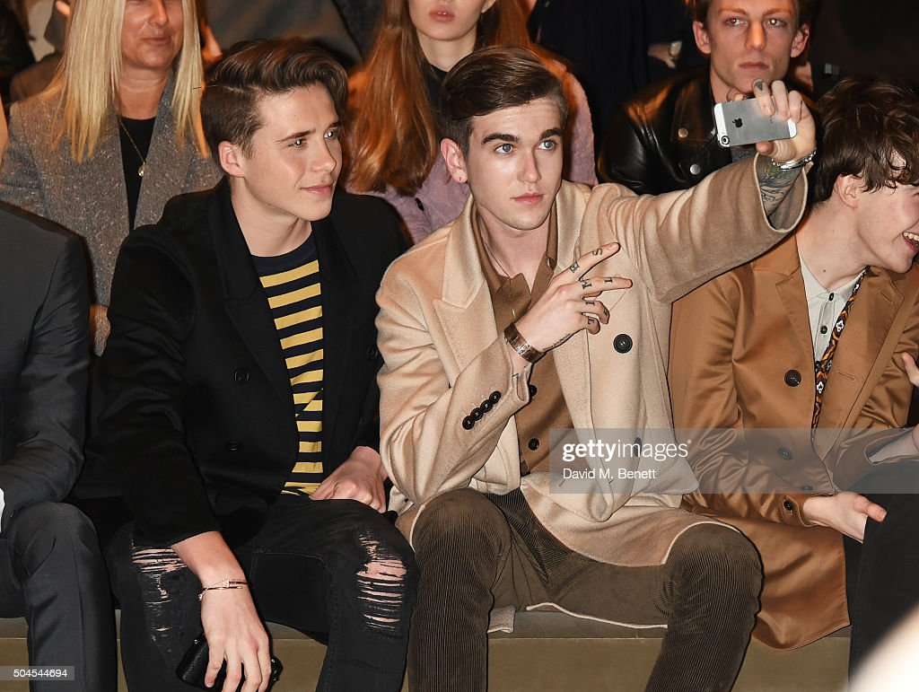 Brooklyn Beckham (L) and Gabriel Day-Lewis attend the Burberry Menswear January 2016 Show on January 11, 2016 in London, United Kingdom.
