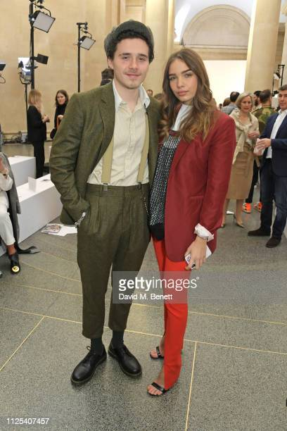 Brooklyn Beckham and Hana Cross attend the Victoria Beckham show during London Fashion Week February 2019 at Tate Britain on February 17 2019 in...