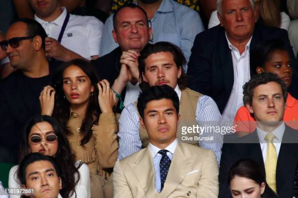 Brooklyn Beckham and Hana Cross look on as they attend the Men's Singles final between Novak Djokovic of Serbia and Roger Federer of Switzerland...