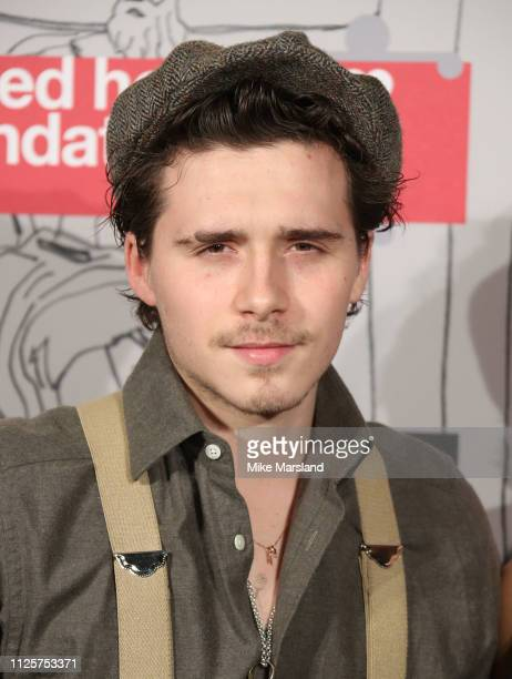 Brooklyn Beckham arrives at the Fabulous Fund Fair event during London Fashion Week February 2019 at the The Roundhouse on February 18 2019 in London...