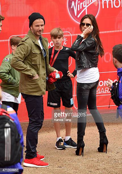 Brooklyn Beckham Cruz Beckham David Beckham and Victoria Beckham congratulate Romeo Beckham after he finished the Childrens Marathon during the...