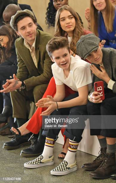 Brooklyn Beckham, Cruz Beckham, Hana Cross and Romeo Beckham attend the Victoria Beckham show during London Fashion Week February 2019 at Tate...
