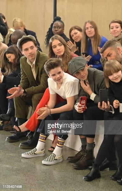 Brooklyn Beckham Cruz Beckham Hana Cross Romeo Beckham David Beckham and Harper Beckham attend the Victoria Beckham show during London Fashion Week...