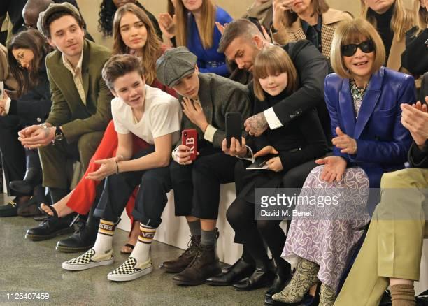 Brooklyn Beckham, Cruz Beckham, Hana Cross, Romeo Beckham, David Beckham, Harper Beckham and Dame Anna Wintour attend the Victoria Beckham show...