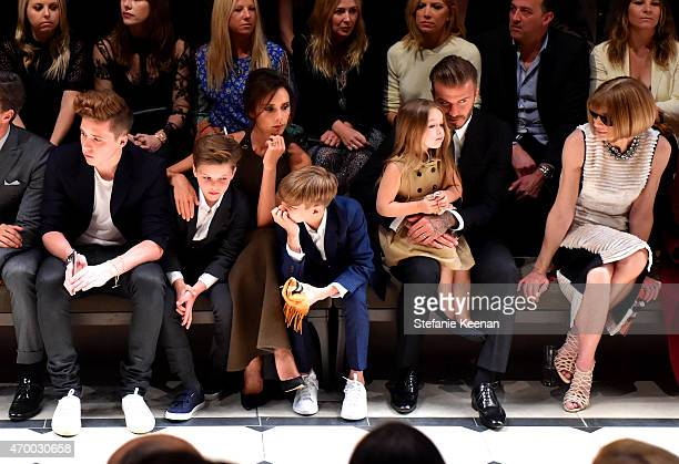 Brooklyn Beckham Cruz Beckham Victoria Beckham Romeo Beckham Harper Beckham David Beckham and editorinchief of American Vogue Anna Wintour attend the...