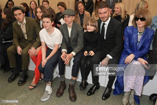 Brooklyn Beckham Hana Cross Cruz Beckham Romeo Beckham Harper Beckham David Beckham and Dame Anna Wintour attend the Victoria Beckham show during...