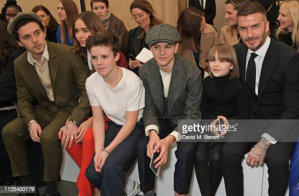 Brooklyn Beckham Hana Cross Cruz Beckham Romeo Beckham Harper Beckham and David Beckham attend the Victoria Beckham show during London Fashion Week...