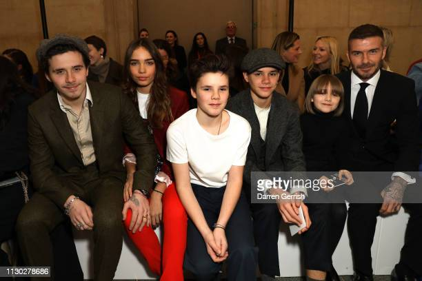 Brooklyn Beckham Hana Cross Cruz Beckham Romeo Beckham Harper Beckham and David Beckham attends the Victoria Beckham show during London Fashion Week...