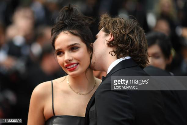 Brooklyn Beckham kisses his partner British model Hana Cross as they arrive for the screening of the film Once Upon a Time in Hollywood at the 72nd...