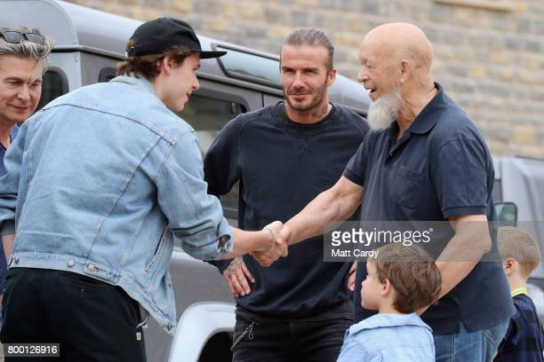 Brooklyn Beckham meets Glastonbury Festival founder Michael Eavis with his father David Beckham at the opening of houses on Maggie's Farm along with...