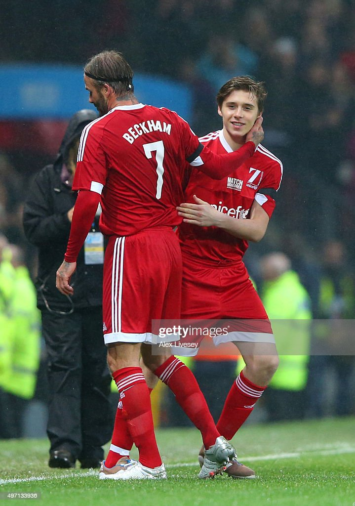 Brooklyn Beckham of Great Britain and Ireland comes on as a substitute for his father, David Beckham during the David Beckham Match for Children in aid of UNICEF between Great Britain & Ireland and Rest of the World at Old Trafford on November 14, 2015 in Manchester, England.