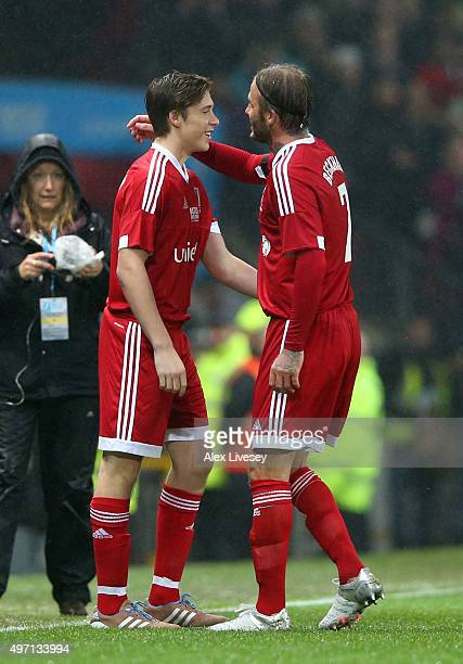 Brooklyn Beckham of Great Britain and Ireland comes on as a substitute for his father David Beckham during the David Beckham Match for Children in...