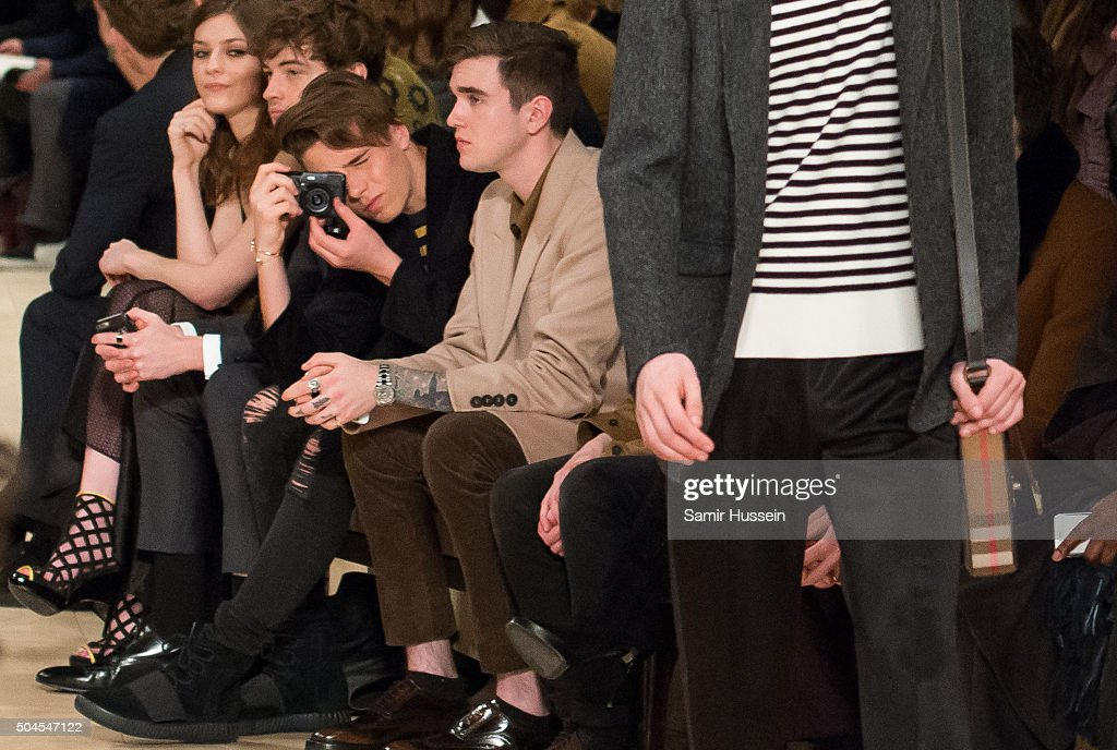 Brooklyn Beckham takes a photo as Gabriel Day-Lewis looks on during the runway at the Burberry show during The London Collections Men AW16 at Kensington Gardens on January 11, 2016 in London, England.