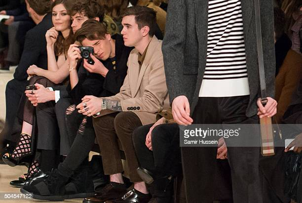 Brooklyn Beckham takes a photo as Gabriel DayLewis looks on during the runway at the Burberry show during The London Collections Men AW16 at...