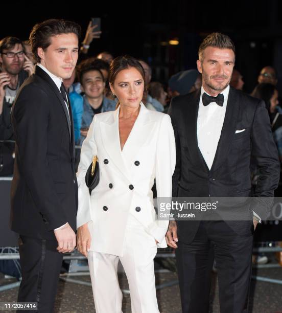 Brooklyn Beckham Victoria Beckham and David Beckham attend the GQ Men Of The Year Awards 2019 at Tate Modern on September 03 2019 in London England