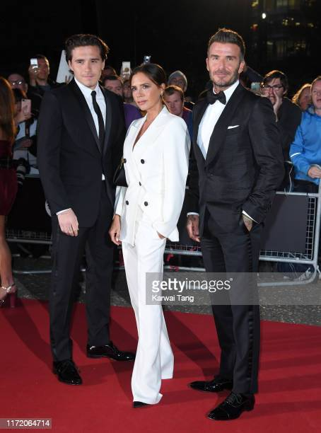 Brooklyn Beckham, Victoria Beckham and David Beckham attend the GQ Men Of The Year Awards 2019 at Tate Modern on September 03, 2019 in London,...