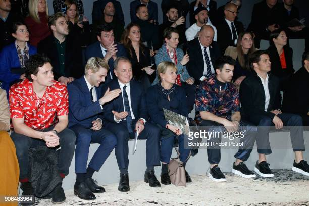 Brooklyn Beckham Xavier Dolan CEO of Louis Vuitton Michael Burke his wife Brigitte Burke Joe Jonas and James Mardsen attend the Louis Vuitton...
