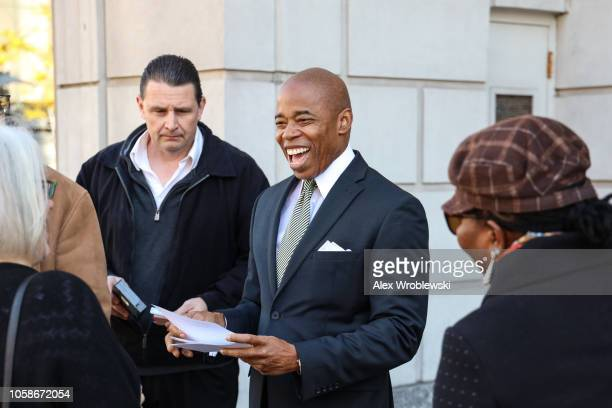 Brooklyn Borough President Eric Adams speaks with residents before holding a news conference regarding New York City's Midterm Elections polling...