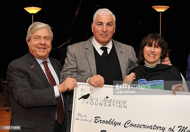 Brooklyn Borough President Marty Markowitz poses with late Singer Amy Winehouse's parents Mitch Winehouse and Janis Winehouse at the Amy Winehouse...
