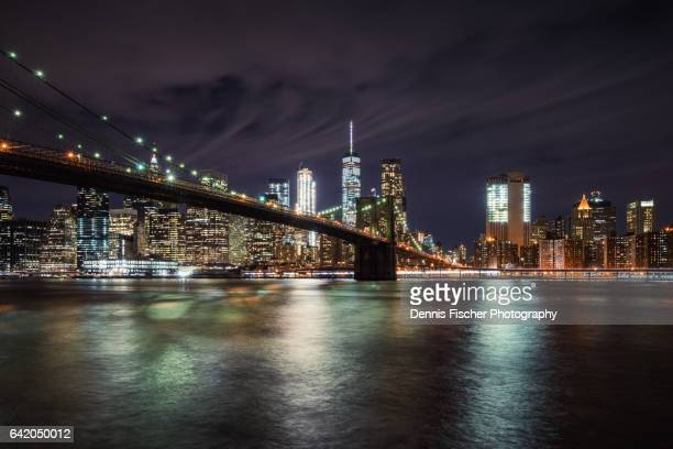 Brooklyn Bridge and Downton NYC with storm clouds