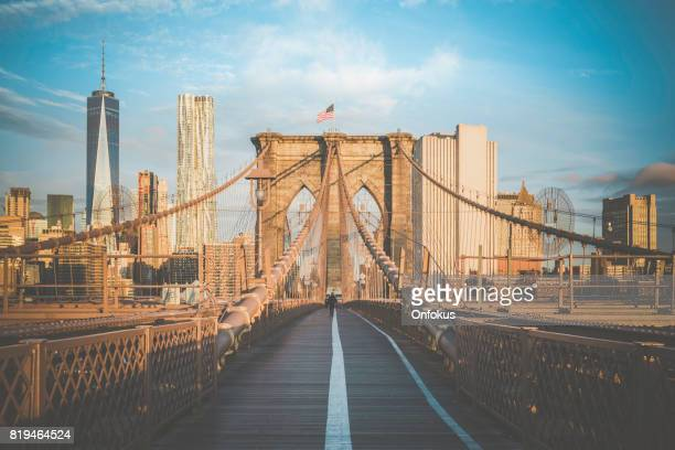 brooklyn bridge and lower manhattan at sunrise, new york city - brooklyn bridge stock pictures, royalty-free photos & images