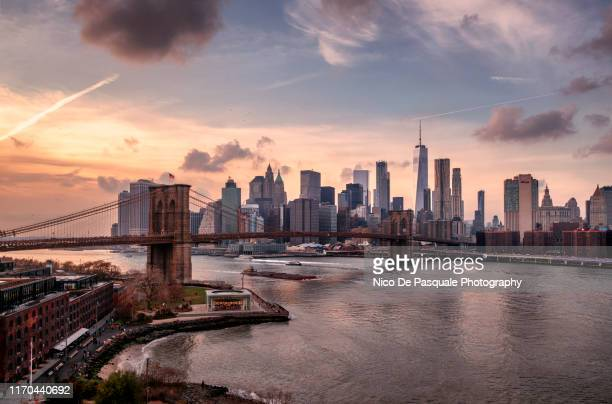 brooklyn bridge and lower manhattan - skyline stock pictures, royalty-free photos & images