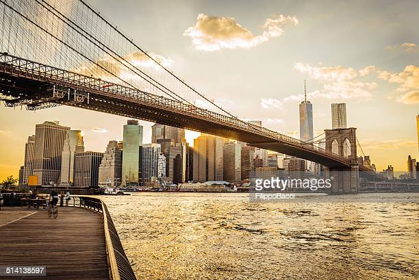 brooklyn bridge and manhattan at sunset - brooklyn bridge stock pictures, royalty-free photos & images
