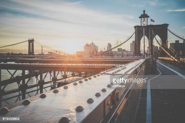 brooklyn bridge and manhattan bridge at sunrise, new york city - footbridge stock photos and pictures