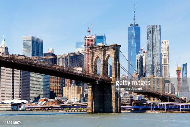 brooklyn bridge and manhattan downtown skyline, new york, usa - brooklyn bridge stock pictures, royalty-free photos & images