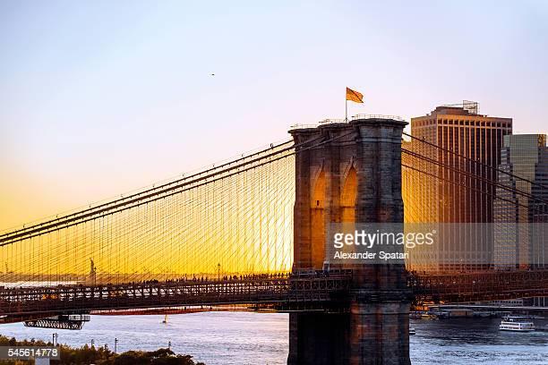 Brooklyn Bridge and Manhattan skyline at sunset, New York City, NY, United States