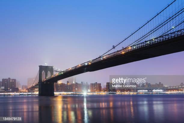 brooklyn bridge and manhattan skyline, new york, usa - brooklyn new york stock pictures, royalty-free photos & images