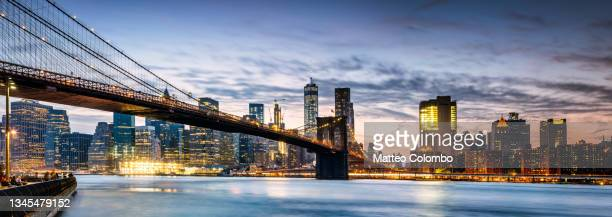 brooklyn bridge at dusk, new york city, usa - brooklyn new york stock pictures, royalty-free photos & images