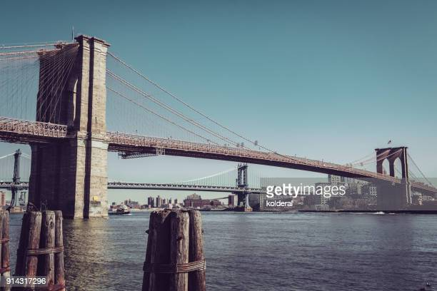 brooklyn bridge at midday - brooklyn bridge stock pictures, royalty-free photos & images