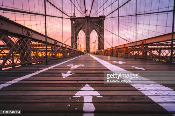 brooklyn bridge at sunrise, new york city - brooklyn bridge stock pictures, royalty-free photos & images
