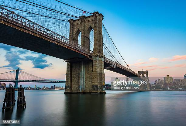 brooklyn bridge during sunset - brooklyn bridge stock pictures, royalty-free photos & images