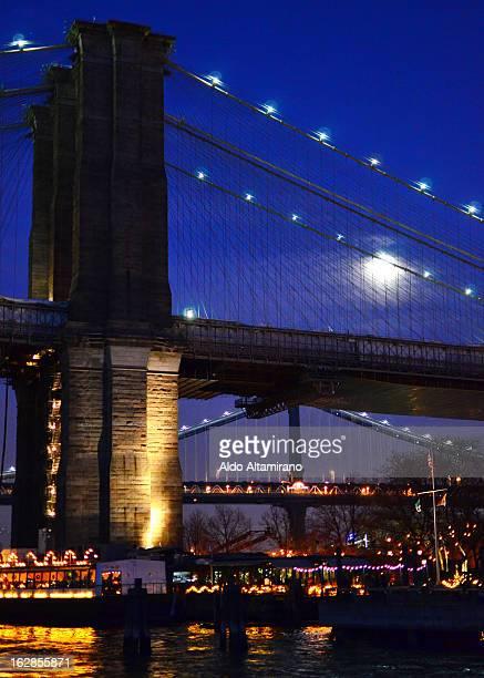 Brooklyn Bridge from Brooklyn Bridge Park. Bridge, park, night, river, water, waterfront, night, dusk, moon, clouds, cloudy, architecture, classic,...