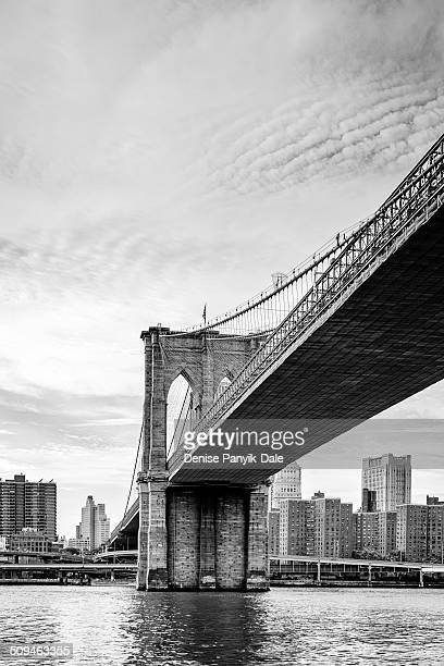 brooklyn bridge from east river - national_historic_landmark stock pictures, royalty-free photos & images