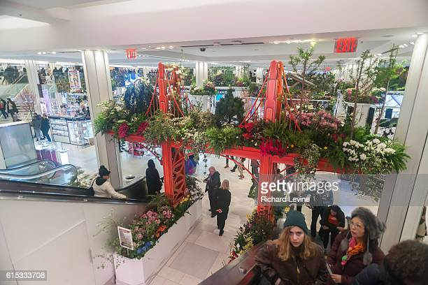 A Brooklyn Bridge in Macy's flagship department store in Herald Square in New York is festooned with floral arrangements during the 42nd annual...