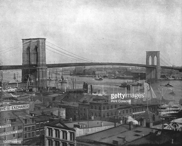 Brooklyn Bridge, New York, USA, circa 1900. Cable-stayed/suspension bridge over the East River. Started in 1869, it is one of the oldest road bridges...