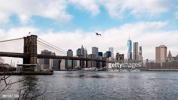 Brooklyn Bridge Over East River Against One World Trade Center In City