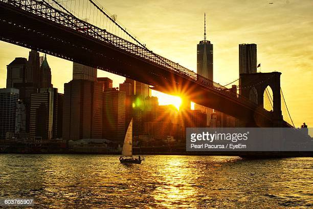Brooklyn Bridge Over East River At Sunset
