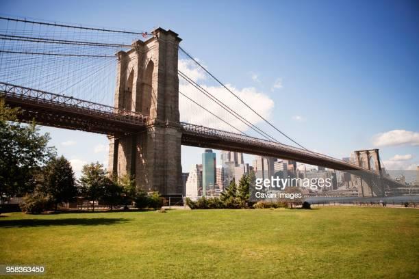 brooklyn bridge park against sky - brooklyn bridge stock pictures, royalty-free photos & images