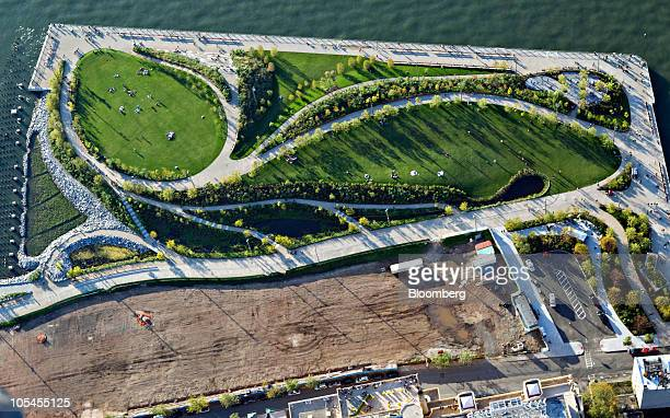 Brooklyn Bridge Park stands next to the East River in this aerial photograph taken over New York, U.S., on Saturday, Oct. 2, 2010. New York City sold...