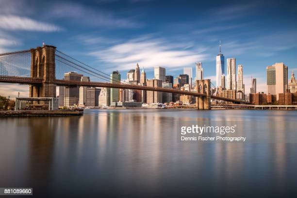 brooklyn bridge view with manhattan skyline - one world trade center stock pictures, royalty-free photos & images