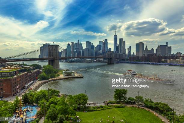 brooklyn bridge with manhattan skyline - south street seaport stock pictures, royalty-free photos & images