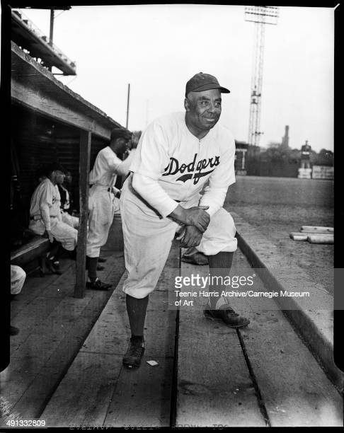 Brooklyn Brown Dodgers baseball manager Oscar Charleston posing in dugout at Forbes Field, Pittsburgh, Pennsylvania, May 1945.