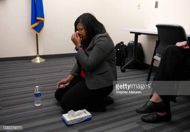 Brooklyn Center city council member Marquita Butler reacts after viewing the body camera footage of the killing of 20-year-old Daunte Wright after it...