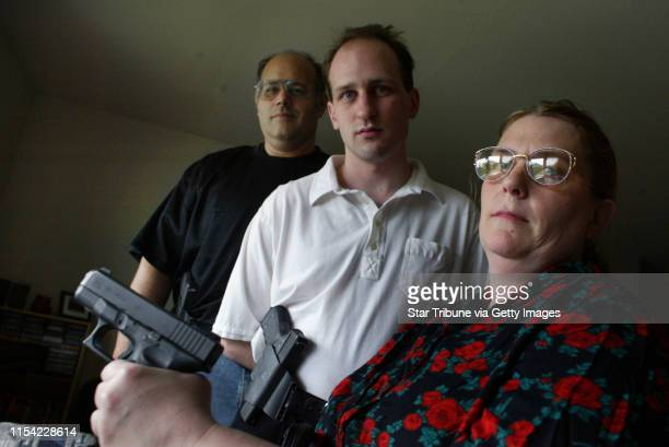 Brooklyn Center MN 6/10/03Nathan Smith surrounded by his parents Loren left and Kim Smith standing at his house with their glock pistols Nathan...